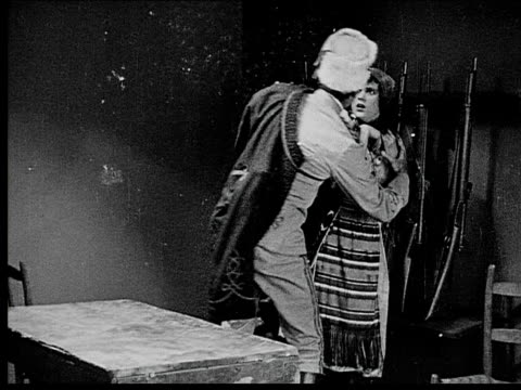 1916 b/w medium shot soldier forcing himself on captured peasant woman/ woman pushing him away/ title card with woman declaring she is the queen - 1916 stock videos & royalty-free footage