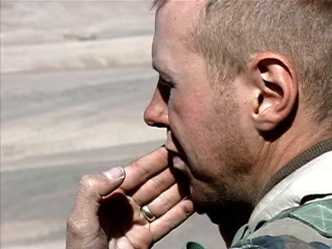 Medium shot soldier shaving/ Afghanistan
