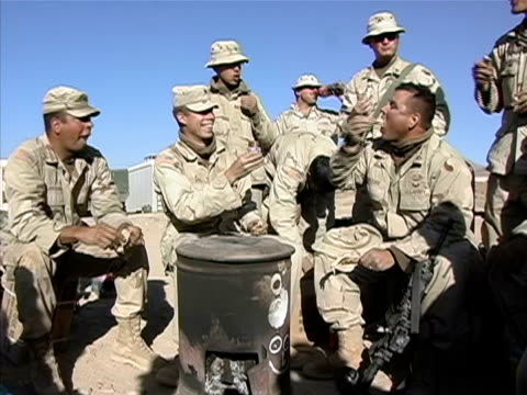 Medium shot soldiers eating turkey dipping in jar of cranberry sauce/ Afghanistan