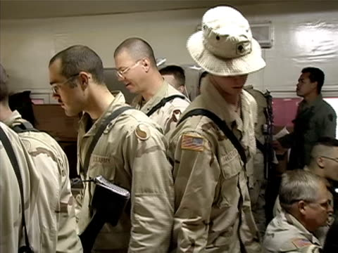 medium shot soldiers in line for food at us military mess hall/ afghanistan - operazione enduring freedom video stock e b–roll