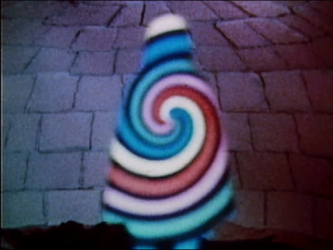 1973 medium shot spinning colored spiral / woman in white cape appearing and speaking / audio - magician stock videos & royalty-free footage