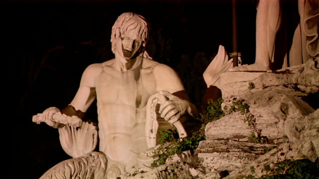 medium shot statue of triton in fountain in piazza del popolo / rome, italy - mythology stock videos & royalty-free footage