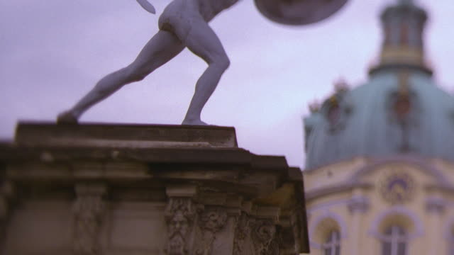 medium shot statue with dome of charlottenburg palace in background / berlin, germany - charlottenburg palace stock videos & royalty-free footage