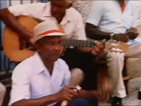 2003 medium shot street musicians playing instruments and singing / cuba - maraca stock videos & royalty-free footage