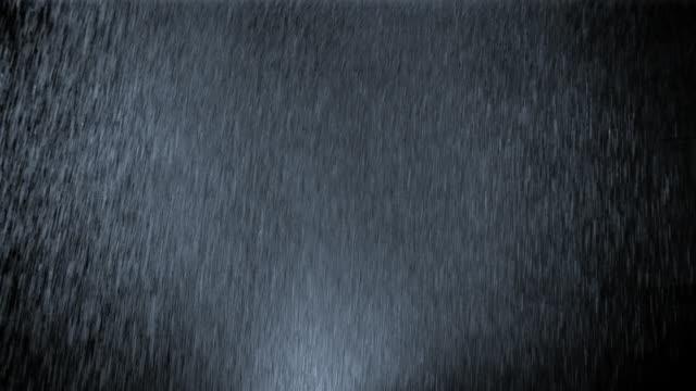 Medium shot studio shot of heavy rain at night