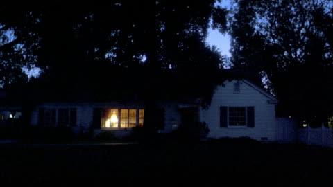 medium shot suburban house at night / inside light turning off - house stock videos & royalty-free footage