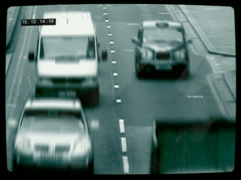 Medium shot surveillance CAM traffic computer generated image car and driver identification