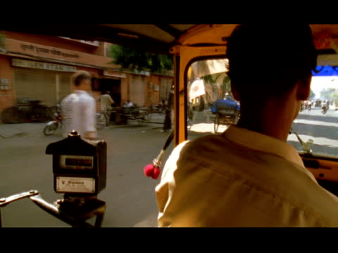 medium shot taxi passenger point of view riding along busy street - taxi driver stock videos and b-roll footage
