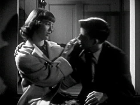 1952 medium shot teen boy and sitting on porch step/ boy trying to kiss girl as she pushes him away/ boy aggressively trying again to kiss girl/ audio - refusing stock videos & royalty-free footage