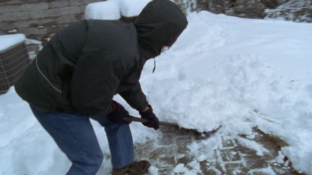 medium shot teenage boy shoveling snow off sidewalk / high bridge, new jersey - spade stock videos & royalty-free footage