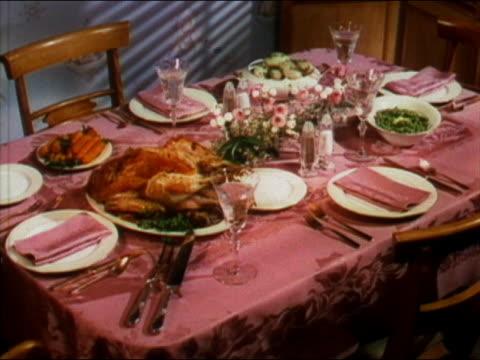 1949 medium shot thanksgiving dinner table with turkey - roast turkey stock videos & royalty-free footage