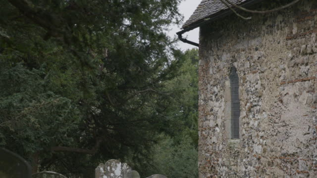 medium shot the south side of the st martins church in canterbury - evergreen stock videos & royalty-free footage