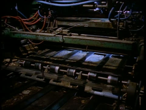 medium shot thin strips of wood passing through machine at lumber plant - paper mill stock videos & royalty-free footage