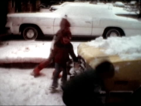 stockvideo's en b-roll-footage met 1983 medium shot three kids having snowball fight in driveway - alleen jongens