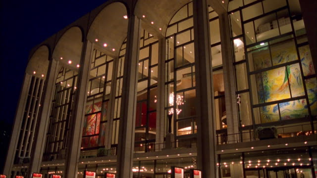 Medium shot through windows of Metropolitan Opera House / NYC