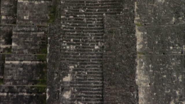Medium shot tilt down tilt upTemple of the Grand Jaguar at Great Plaza Mayan Ruins / Tikal, Guatemala