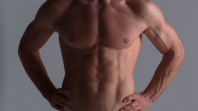 vidéos et rushes de medium shot tilt up chest of young man / london - underwear