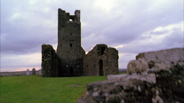 medium shot tilt up stone castle ruins / cork, ireland - 2002 stock videos & royalty-free footage