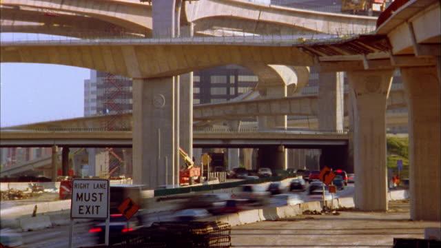 medium shot time lapse traffic on high five interchange construction area / dallas - 2004点の映像素材/bロール
