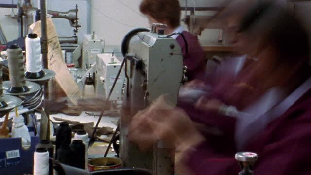vídeos y material grabado en eventos de stock de medium shot time lapse women operating sewing machines in shoe factory / korea - coreano oriental