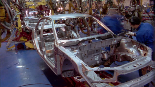 medium shot time lapse workers assembling cars in gm car factory / cairo, egypt - general motors stock videos & royalty-free footage