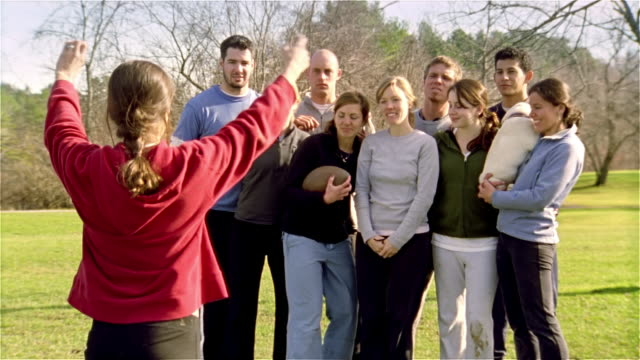 medium shot touch football team posing for group photo/ maine - touch football video stock e b–roll