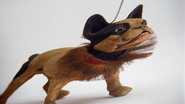 Medium shot toy dog barking and bobbing head