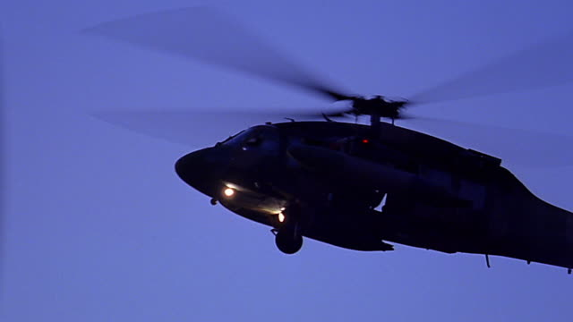medium shot tracking shot blackhawk helicopter helicopter flying - black hawk helicopter stock videos and b-roll footage