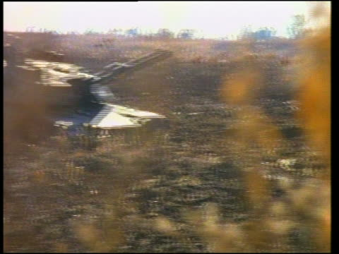 stockvideo's en b-roll-footage met medium shot tracking shot tank moving through field / camp shelby, mississippi - onbekend geslacht