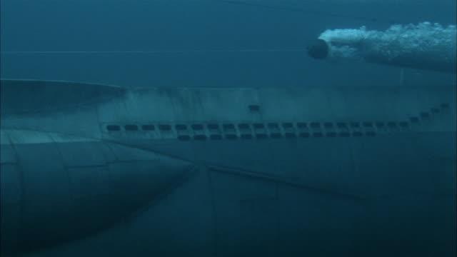 medium shot tracking shot torpedo propelling past submerged world war ii submarine - single object stock videos & royalty-free footage