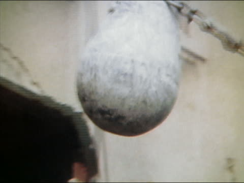 stockvideo's en b-roll-footage met 1961 medium shot tracking shot wrecking ball smashing into building - medium filmcompositietype