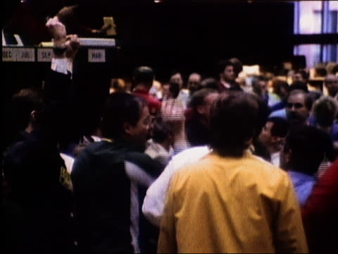 1987 medium shot traders on exchange floor gesturing and writing / chicago board of trade / audio - 1987 bildbanksvideor och videomaterial från bakom kulisserna