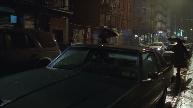 medium shot traffic on city street in rain / pan to front door of apartment building / lower east side, nyc - no parking sign stock videos & royalty-free footage