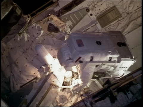 medium shot two astronauts working on the international space station during space walk / sts-114 - stephen robinson astronaut stock videos & royalty-free footage