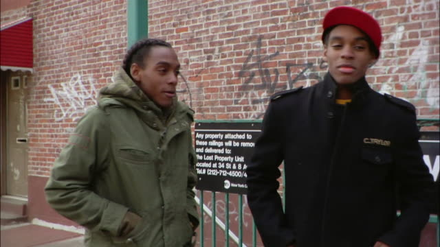 medium shot two brothers showing off their knuckle rings and giving each other street handshakes near subway sign / new york city, new york, usa - african american ethnicity stock videos & royalty-free footage