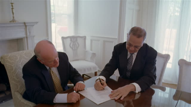 medium shot two businessmen at table/ solebury, pennsylvania - signature stock videos and b-roll footage