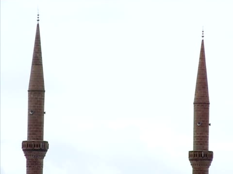 Medium shot Two minarets standing side by side/ Turkey