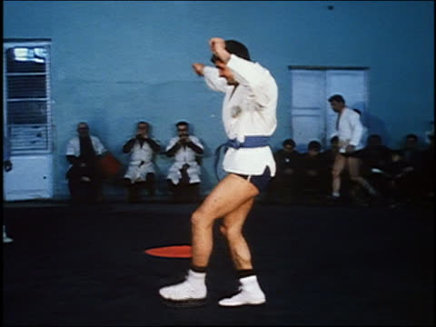 1967 medium shot two wrestlers dancing for audience before match / musicans in background /AUDIO /Armenia