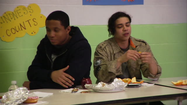 Medium shot Two young men arguing in cafeteria / New York City, New York, USA