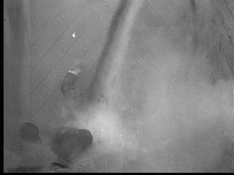 stockvideo's en b-roll-footage met 1909 b/w medium shot tycoon falling into grain pit and being covered by pouring grain  - 1900 1909