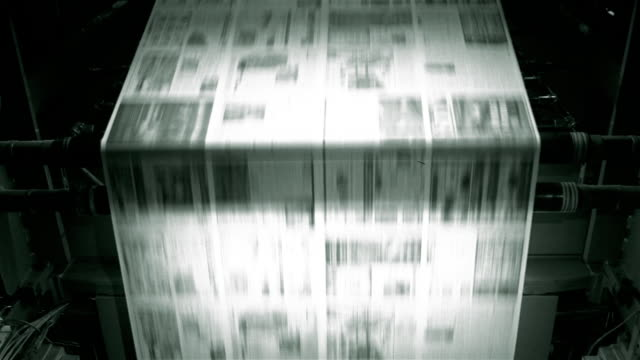 stockvideo's en b-roll-footage met medium shot uncut newspapers moving across roller and downward in printing press at santa barbara news press / santa barbara, california - krant