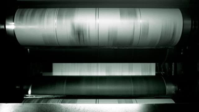 medium shot uncut sheet of santa monica news press newspaper being printed with different inks / santa barbara, california - ジャーナリズム点の映像素材/bロール