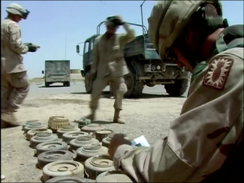 medium shot us troops carefully laying mines on the ground / ghazni afghanistan / audio - instruction manual stock videos and b-roll footage