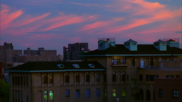 medium shot view of city buildings under cloudy sky at dusk / new jersey - 1995 stock videos & royalty-free footage
