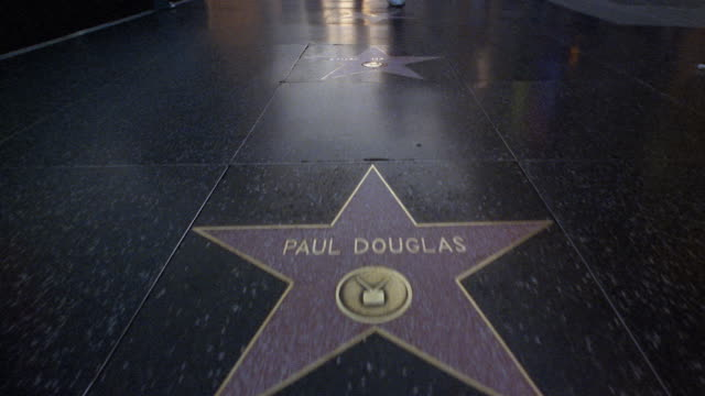 stockvideo's en b-roll-footage met medium shot walking point of view looking down at stars on hollywood walk of fame / los angeles - hollywood walk of fame