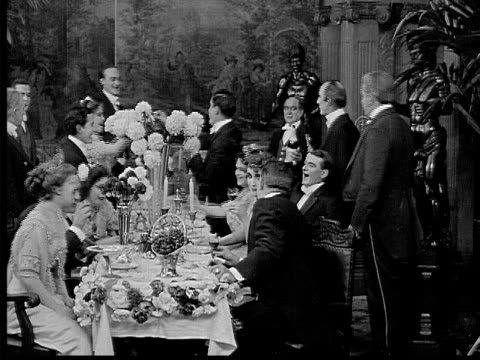 1909 b/w medium shot wealthy people having dinner  - 無声映画点の映像素材/bロール