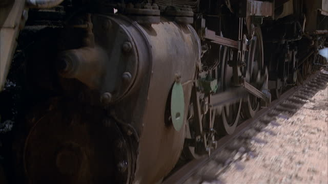 medium shot wheels of steam locomotive traveling on track - north africa stock videos & royalty-free footage