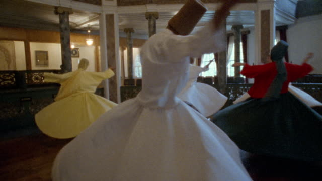 medium shot whirling dervishes spinning in mosque / istanbul, turkey  - sufism stock videos & royalty-free footage