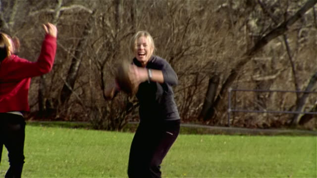 medium shot woman catching pass in touch football game and scoring touchdown/ maine - touch football stock videos & royalty-free footage