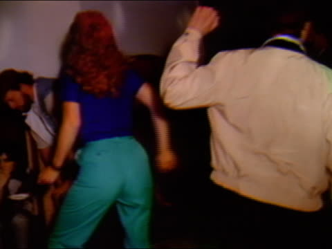1984 medium shot woman dancing badly at nightclub - halbnahe einstellung stock-videos und b-roll-filmmaterial